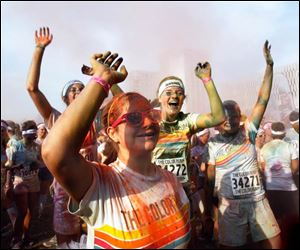 Color Run participants are all smiles during the race.