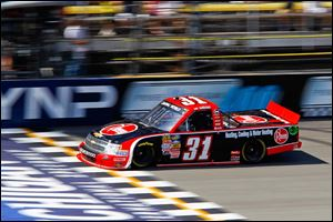 James Buescher (31) crosses the finish line, winning the NASCAR Camping World Truck Series Michigan National Guard 200.