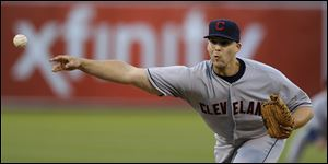Cleveland Indians' Justin Masterson works against the Oakland Athletics in the first inning.