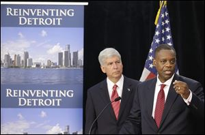 In July, Kevyn Orr, state-appointed emergency manager, right, with Michigan Gov. Rick Snyder, asked for bankruptcy protection. Unions, creditors, and retirees were expected to file formal objections to Detroit's eligibility before today's deadline.