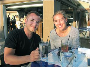 Phil Carothers and Ann Stoiber, both of Perrysburg, enjoy Social's outdoor patio.
