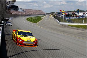 Joey Logano holds a lead in to turn one during the Pure Michigan 400 on Sunday at Michigan International Speedway. He went on to win the race.
