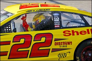 Joey Logano holds up his finger to signal he's No. 1 after taking the checkered flag at the Pure Michigan 400 on Sunday.