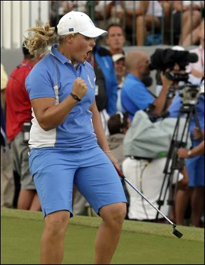 Europe's Caroline Hedwall celebrates after making a birdie putt on the 18th hole to give her the win over American Michelle Wie during the singles matches at the Solheim Cup on Sunday in Parker, Colo. The win gave Europe 14 points as they retained the Solheim Cup.
