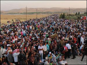 Syrian refugees cross the border toward Iraq at Peshkhabour border point at Dahuk, 260 miles northwest of Baghdad, Iraq, on Aug. 15.