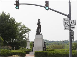 A proposal to renovate Perrysburg's riverfront includes moving the statue of Commodore Perry down the slope between Front Street and the Maumee River to offer a better view of the river.
