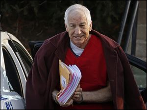 Former Penn State assistant football coach Jerry Sandusky arrives at the Centre County Courthouse for a post-sentencing hearing in Bellefonte, Pa., in January.
