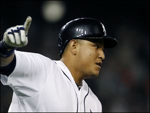 Detroit Tigers' Miguel Cabrera rounds the bases after hitting a walk-off home run that beat the Kansas City Royals Saturday night.