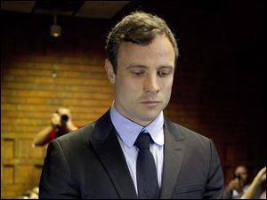 Oscar Pistorius appears at a court in Pretoria, South Africa, today.