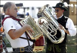 Rob Schwalbe, left, and Erwin Rauschendorfer both of Detroit, play music during the 2012 German-American Festival.