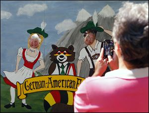Kay Drill, left, and Denise Schick, right, both of Oregon, get their picture taken by Janet Tutera of Marblehead, durin the 2012 German-American Festival in Oregon.