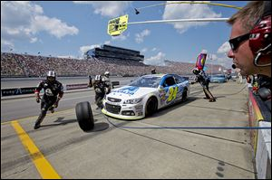 Jeff Gordon stops on pit road during the Pure Michigan 400 at Michigan International Speedway.