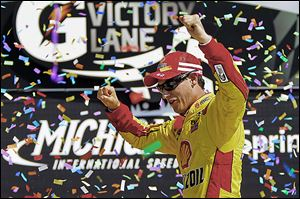 Joey Logano celebrates his NASCAR Sprint Cup Series win Sunday in the Pure Michigan 400 at Michigan International Speedway in Brooklyn. That boosted his chances of making the Chase.