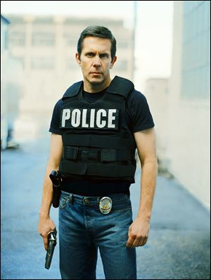 In this publicity photo released by TNT, Gary Cole portrays SWAT officer Conrad Rose in the new TNT cop drama