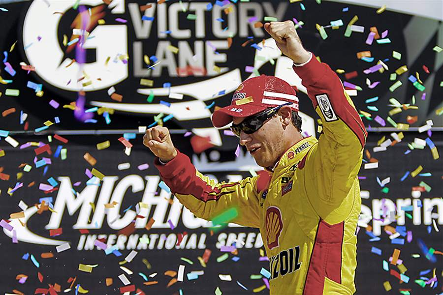 Joey-Logano-celebrates-his