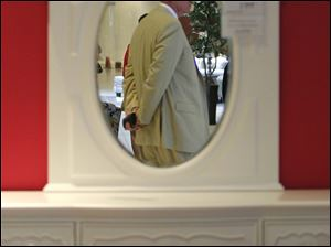 Kim Yost, Art Van Furniture CEO, is reflected in a mirror during the