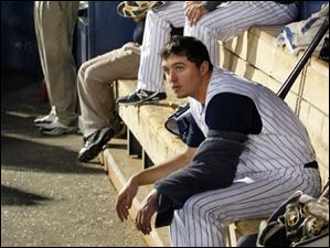 Toledo pitcher Blaine Hardy rests his arm in the dugout during his one-hitter game against Gwinnett.