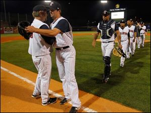 Toledo Mud Hens manager Phil Nevin congratulates winning pitcher Blaine Hardy after he pitched a one-hitter against Gwinnett.