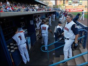 Toledo manager Phil Nevin enters the dugout after coaching third base during game against Gwinnett