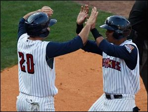 Toledo's Kevin Russo, left, and Argenis Diaz high-five after scoring on a double in the fifth inning.