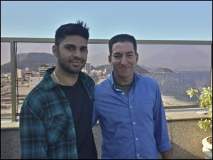 In this undated photo released by Janine Gibson of The Guardian, Guardian journalist Glenn Greenwald, right, and his partner David Miranda.