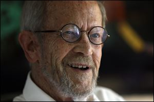 Author Elmore Leonard smiles during an interview at his home in Bloomfield Township, Mich., in August, 2012.