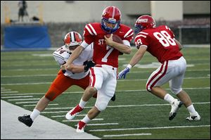 St. Francis quarterback David Nees is pushed out of bounds by Southview's Myles Magnus last season.