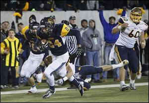 Whitmer's Marcus Elliott runs for a touchdown after recovering a fumble by Cincinnati Moeller in the Division I state championship last season.