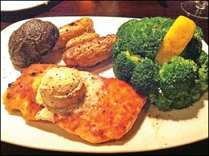 Citrus Parmesan Encrusted Salmon served with roasted fingerling potatoes and vegetable at Gradkowski's.