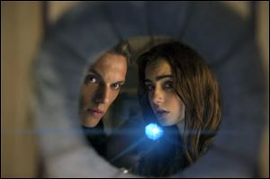 Jamie Campbell Bower as Jace, left, and Lily Collins as Clary in a scene from 'The Mortal Instruments: City of Bones.'