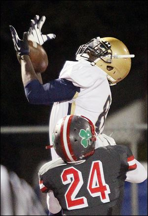 St. John's receiver Craig Mays makes a touchdown catch against Central Catholic.