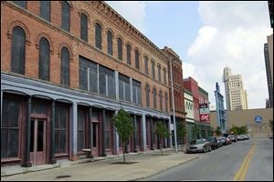 Vacant buildings on St. Clair Street would be refurbished as part of a plan by the Toledo Mud Hens.