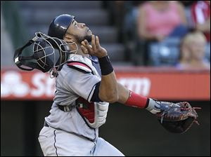 Cleveland Indians catcher Carlos Santana looks to field a bunt by Los Angeles Angels' J.B. Shuck during the seventh inning of a baseball game Wednesday, Aug. 21, 2013, in Anaheim, Calif. Shuck was out at first. (AP Photo/Jae C Hong)