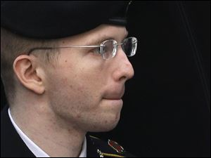Army Pfc. Bradley Manning is escorted into a courthouse in Fort Meade, Md., today before a sentencing hearing in his court martial.