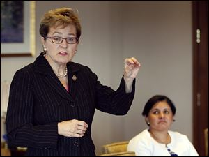 U.S. Rep Marcy Kaptur (D., Toledo), left, and Yvette Sanchez Fuentes, director of the national Office of Head Start, advise Toledo organizations about  a possible collaborative bid for the city's Head Start grant.