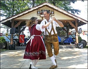 Dawn Krupinsky, left, and her husband Walter, right, from St. Clair Shores, Michigan dance a polka during the German-American Festival in 2011.