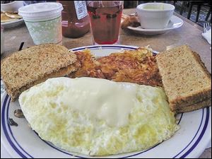 Smothered chicken omelet.