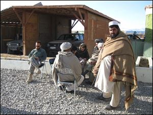 Author Vanessa Gezari interviews elders in Zormat, Afghanistan.