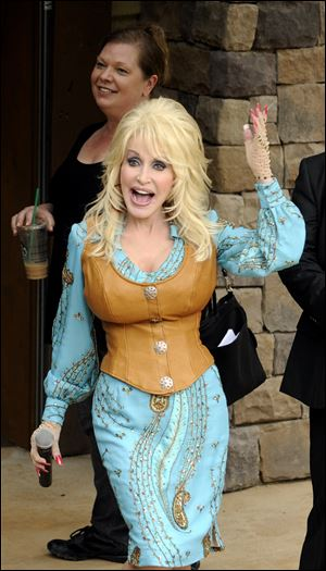 Dolly Parton performs on opening day of the Dollywood theme park season in March, 2012 in Pigeon Forge, Tenn.