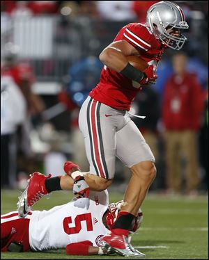 Ohio State tight end Jeff Heuerman makes a catch against  Nebraska last year in Columbus. The junior is a former junior hockey standout. Heuerman and fellow tight end Nick Vannett combined for only 17 catches, 217 yards, and a touchdown last season, but that's expected to change.