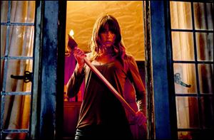 Sharni Vinson wields an axe in a scene from 'You're Next.'