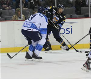 Walleye forward Stephon Thorne prepares to shoot past Icemen defender Jake Obermeyer in a Jan. 27 game at the Huntington Center.