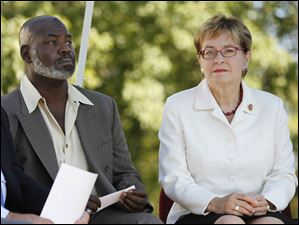 Toledo Mayor Mike Bell sits next to U.S. Rep. Marcy Kaptur (D., Toledo) during the news conference.