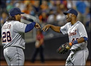 The Tigers' Torii Hunter, right, and Prince Fielder celebrate after their win against the Mets in New York. The Tigers won 6-1.