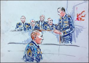 In this courtroom sketch Staff Sgt. Robert Bales, foreground, is seated as prosecutor Lt Col. Jay Morse, right, speaks to the jury in a courtroom at Joint Base Lewis-McChord, Wash. during a sentencing hearing in the slayings of 16 civilians killed during pre-dawn raids on two villages on March 11, 2012.