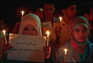 Palestinians in Gaza City protest the Syrian regime and condemn the alleged poison gas attack on the suburbs of Damascus.