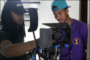 Melvin Claybrooks, left, consults with actor Nehemiah 'Nemo' McCreary during filming of  'Innerview.'