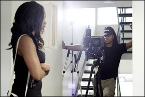 Screenwriter and director Melvin Claybrooks, right, shoots a scene with actor Joslynn Smallwood while filming a short film titled 'Innerview.'