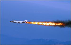 "Virgin Galactic, the company's SpaceShipTwo fires its rockets over Mojave, Calif., after it was dropped from its ""mo"