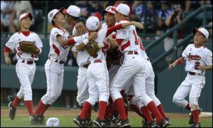 Japan celebrates after its ninth Little League World Series title, a 6-4 win over Chula Vista, Calif.